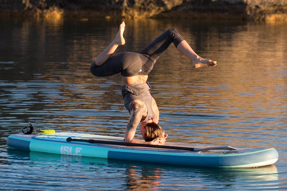Promotional pictures of the ISLE Lotus yoga board in action.
